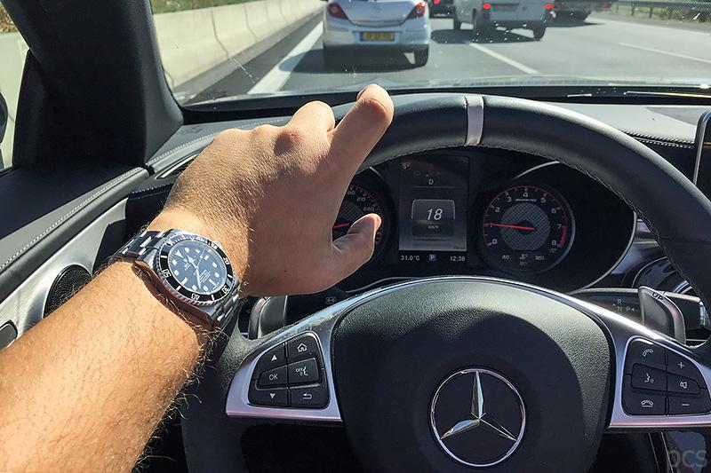 Rolex Submariner 114060 Cockpit Mercedes-AMG C63S Cabrio